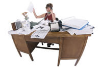 Secretary with busy desk